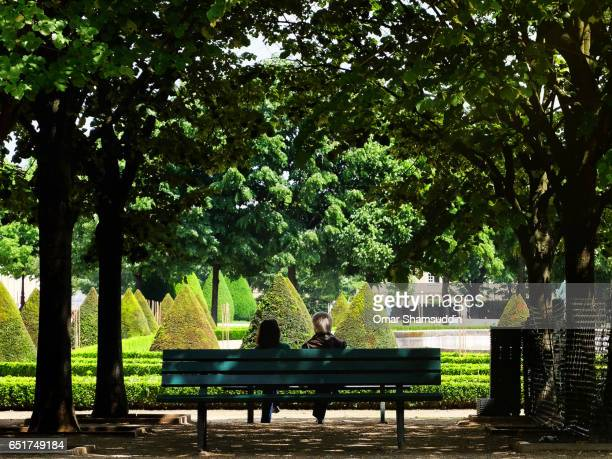 a mature couple sitting under the shade - saint denis paris stock pictures, royalty-free photos & images