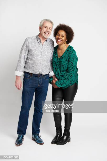 mature couple smiling against white background - plain background stock pictures, royalty-free photos & images