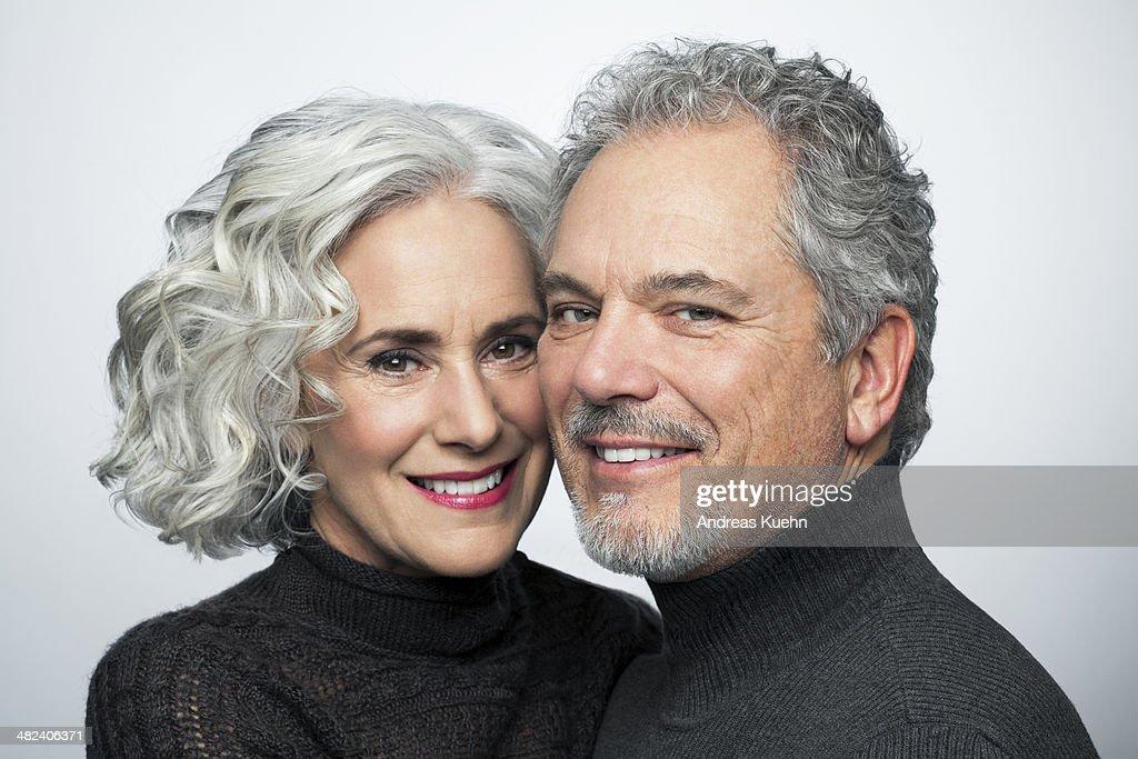 Mature couple smiling for camera, portrait. : Stock Photo