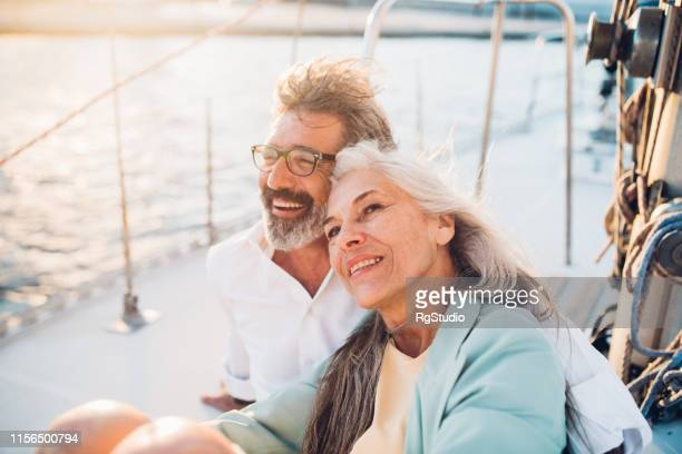 mature couple smiling - sailor stock pictures, royalty-free photos & images