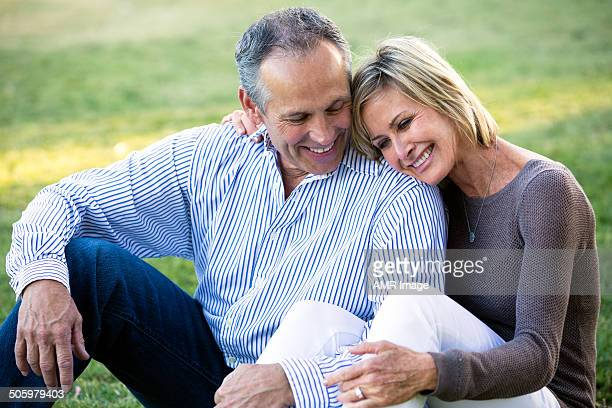 Mature couple snuggled up