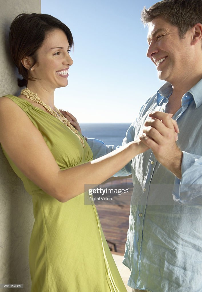 Mature Couple Stand Face to Face Outdoors, Holding Hands : Stock Photo