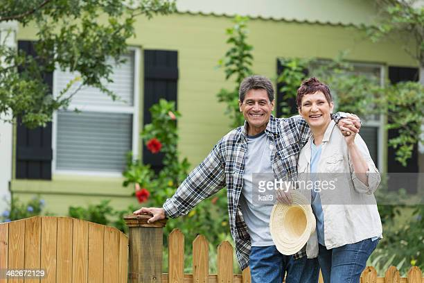 mature couple standing in yard - 50 59 years stock pictures, royalty-free photos & images