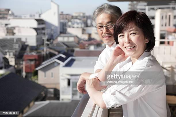 Mature couple standing on balcony