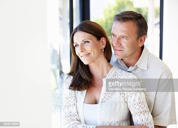 Mature couple staring out the window