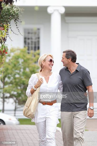 Mature couple strolling along a small town street