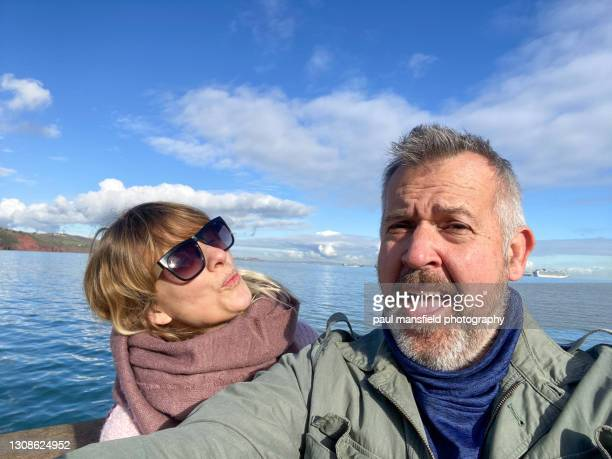 mature couple taking a selfie - couple relationship stock pictures, royalty-free photos & images