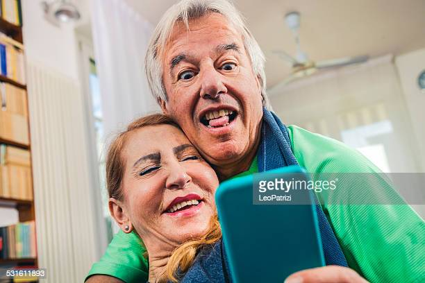 Mature couple taking a selfie post-workout