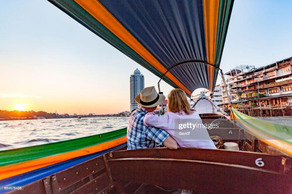 Mature Couple Taking Selfies On A Romantic Sunset Boat Cruise On The River Stock Photo -4047
