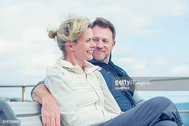 mature couple talking and flirting. - wife stock pictures, royalty-free photos & images