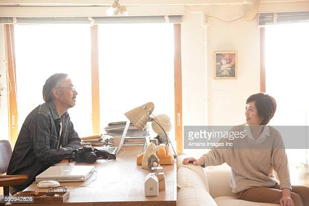 Mature couple talking at home office