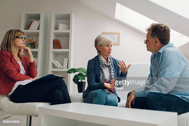Mature Couple Talking to Counselor