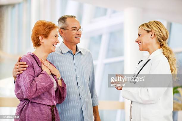 Mature couple thanked her doctor.