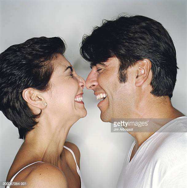 Mature couple touching noses, profile