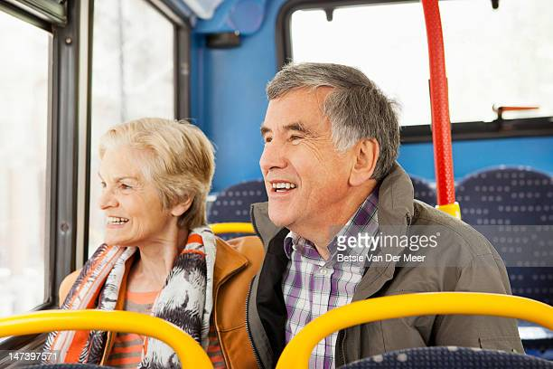 Mature couple traveling by bus.