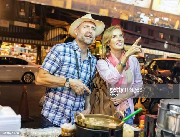 Mature Couple Trying Thai Street Food in Bangkok