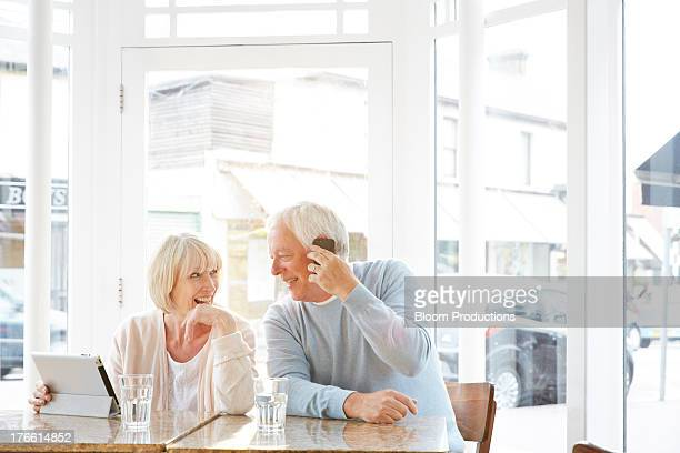 Mature couple using a tablet and smart phone