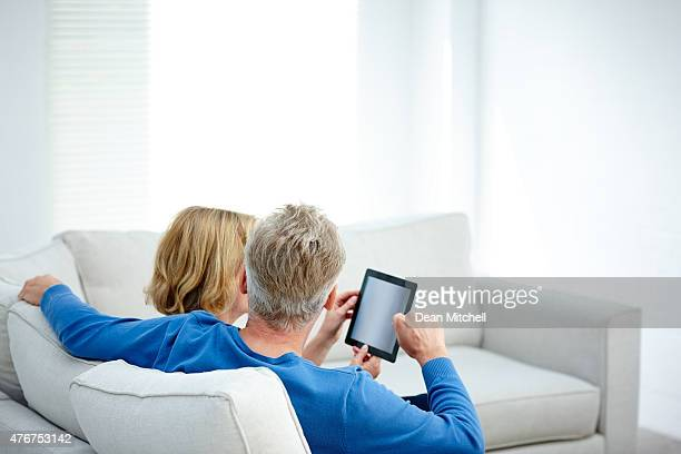 Mature couple using a tablet computer