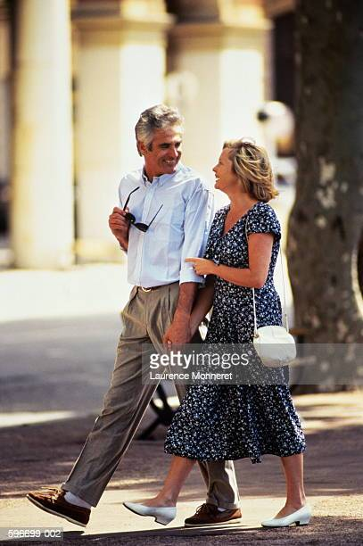 Mature couple walking, holding hands