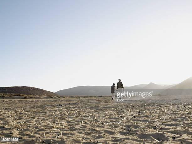 Mature Couple Walking in Desert