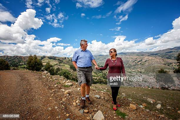Mature couple walking in the Andes countryside above Huaraz