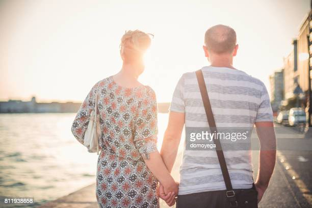 Mature couple walking on the port of the Thessaloniki on a beautiful sunny summer day