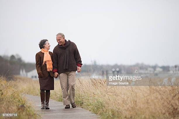 mature couple walking - massachusetts stock pictures, royalty-free photos & images