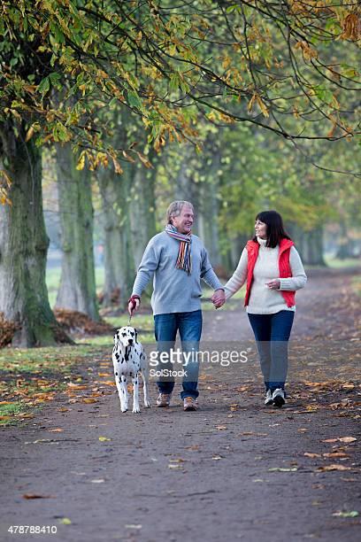 Mature Couple Walking the Dog
