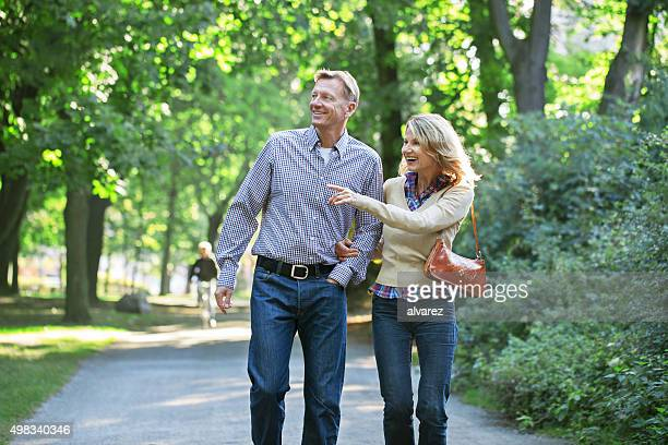 Mature couple walking together in a park