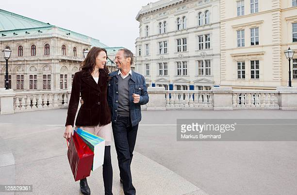 Mature Couple walking with shopping bags.