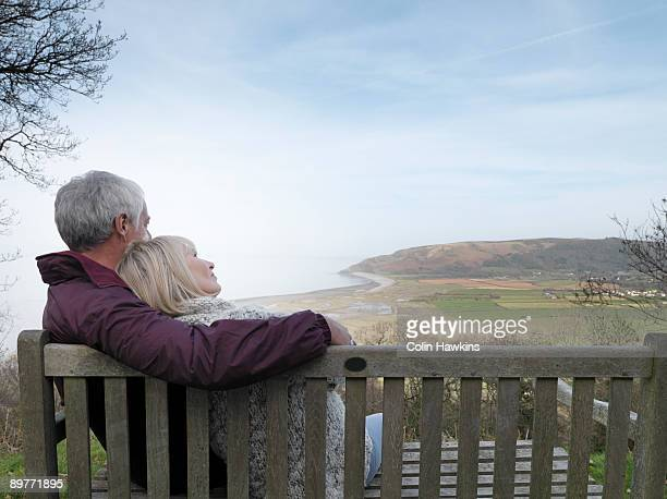 mature couple watching coastal view - colin hawkins stock pictures, royalty-free photos & images