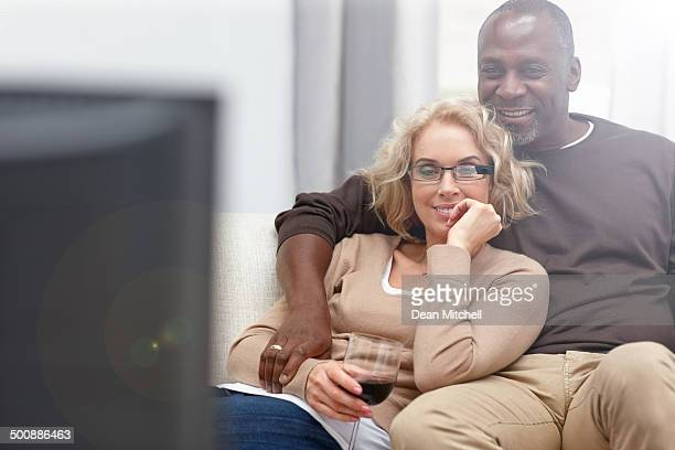 Mature couple watching romantic movie on TV