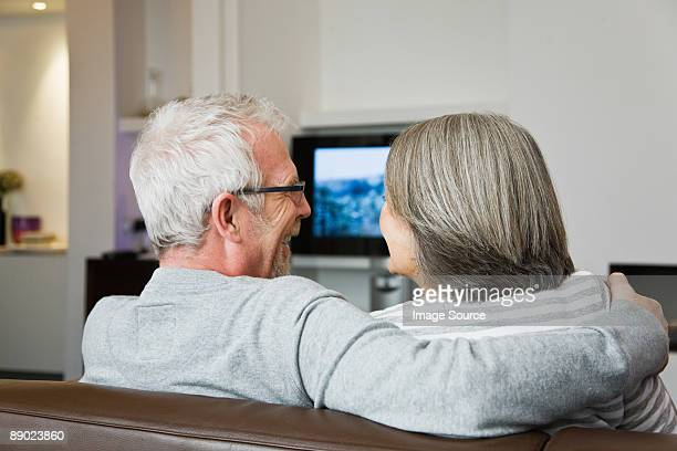 Mature couple watching television