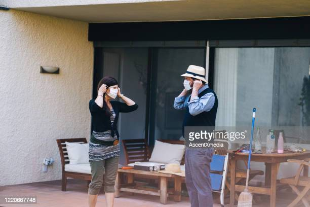 mature couple wear masks to protect from infectious disease - early retirement stock pictures, royalty-free photos & images