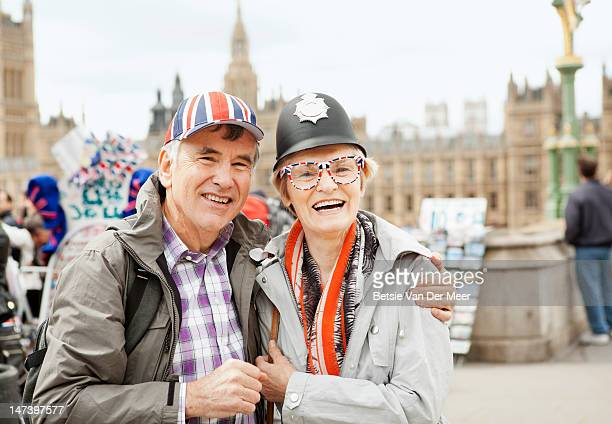 Mature couple wearing tourist hats.