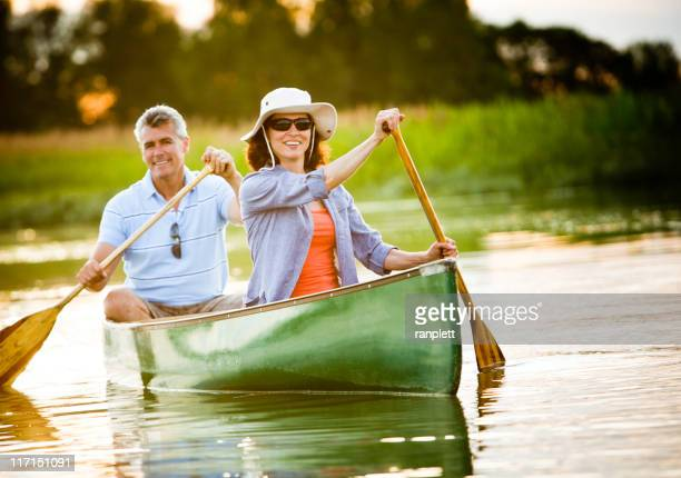 mature couple with a healthy outdoor lifestyle - canoe stock pictures, royalty-free photos & images
