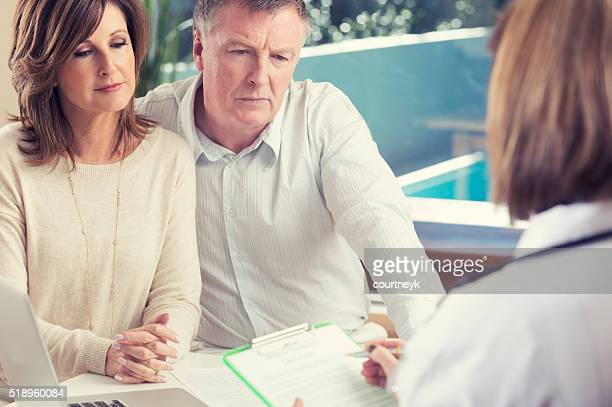 Mature couple with doctor.