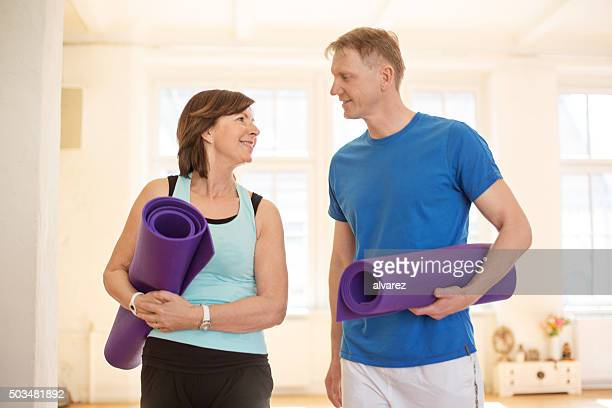 Mature couple with exercise mats