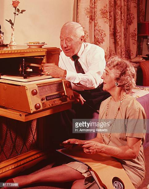 Mature couple with hi-fi. (Photo by H. Armstrong Roberts/Retrofile/Getty Images)