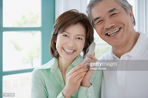 Mature couple with telephone