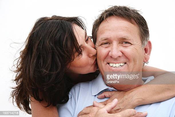 Mature couple Woman hugging and kissing a smiling man
