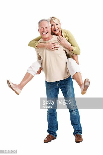mature couple young at heart - piggyback stock pictures, royalty-free photos & images