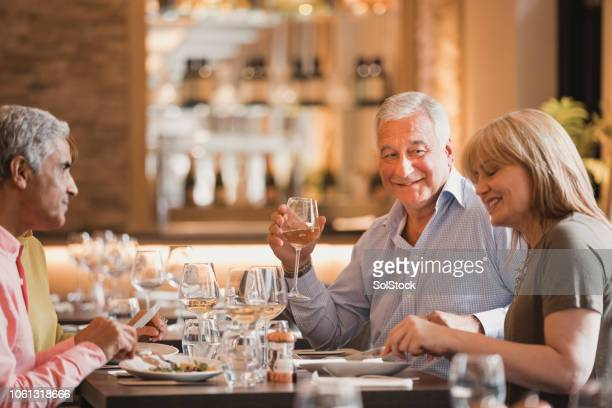 mature couples in a restaurant - 50 59 years stock pictures, royalty-free photos & images