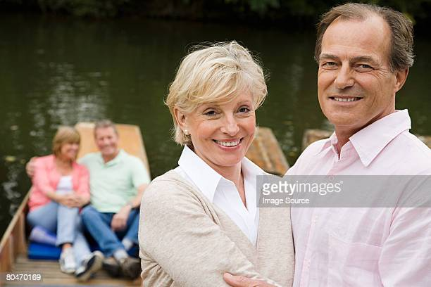 Mature couples on boating trip
