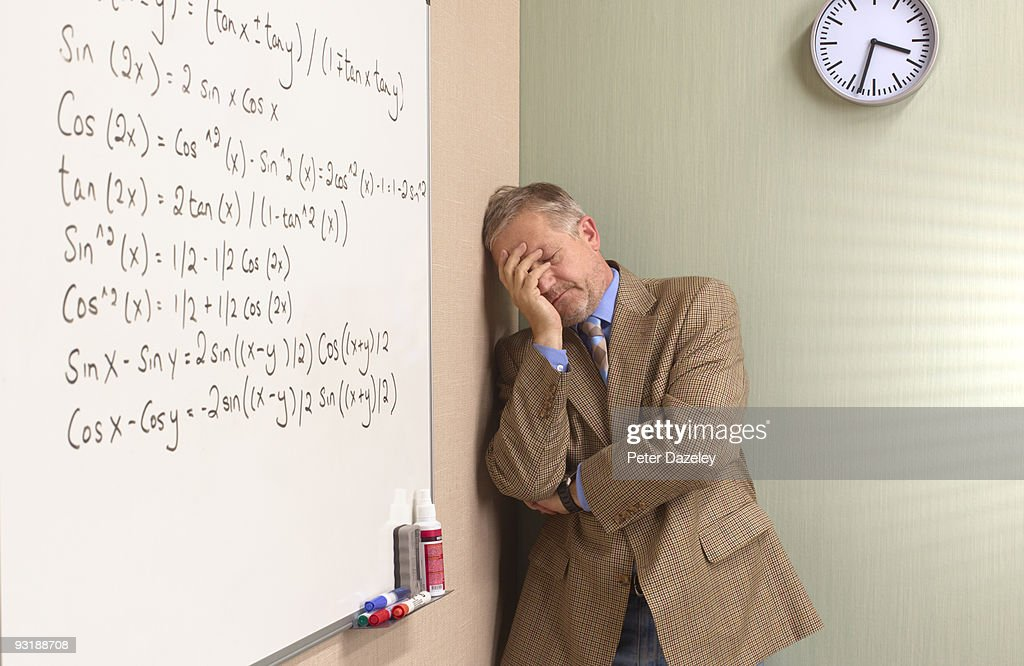 Mature depressed maths teacher : Stock Photo
