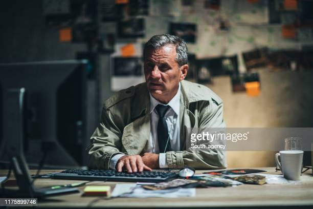 mature detective working in office - police chief stock pictures, royalty-free photos & images
