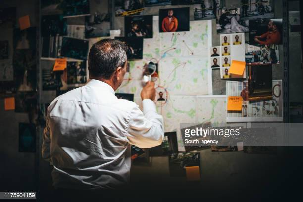 mature detective working late on a case - mystery stock pictures, royalty-free photos & images