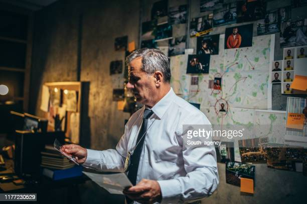 mature detective working late - killing stock pictures, royalty-free photos & images