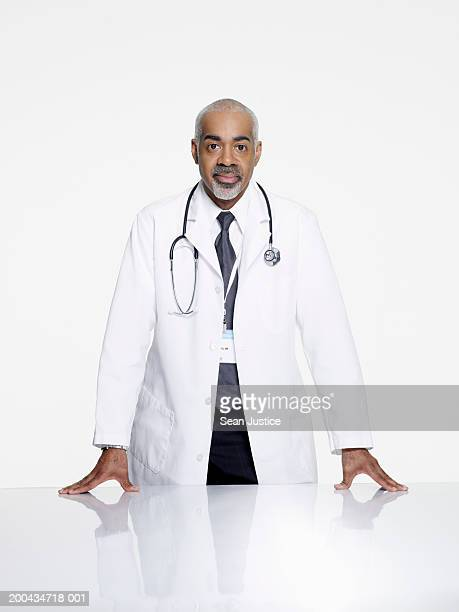 mature doctor, portrait, close-up - part of a series stock pictures, royalty-free photos & images