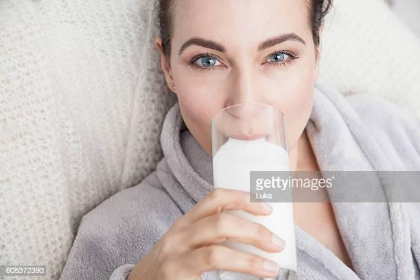 Mature drinking a glass of milk